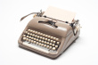 stock-photo-13139399-typewriter-isolated-on-white.jpg